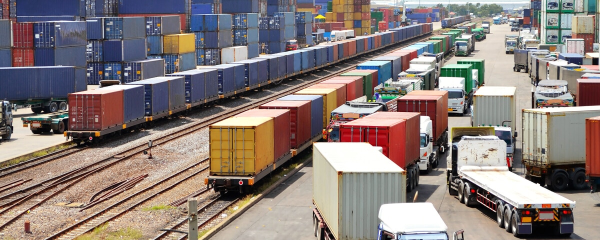 Intermodal land transport of goods by truck or train